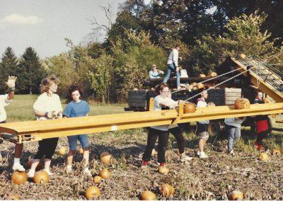 Loading pumpkins into bins with conveyor 1989