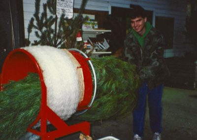 Bryan Trax wrapping Christmas trees 1994