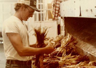 Chuck Trax tying Indian corn 1981