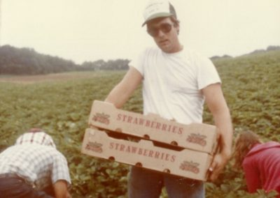 Bobby Trax carrying strawberries from the field - 1982