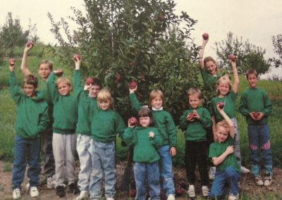 1991 Trax kids picking apples